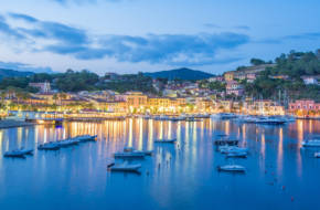 Panoramic view over the famous town Porto Azzurro in sunset light, in Elba island of Italy, Europe